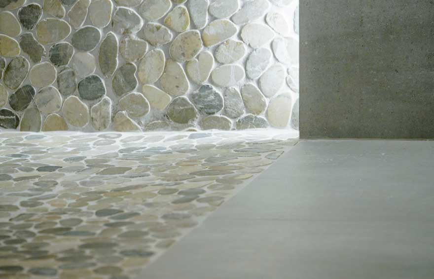 Detail of stone and porcelain flooring in bathroom