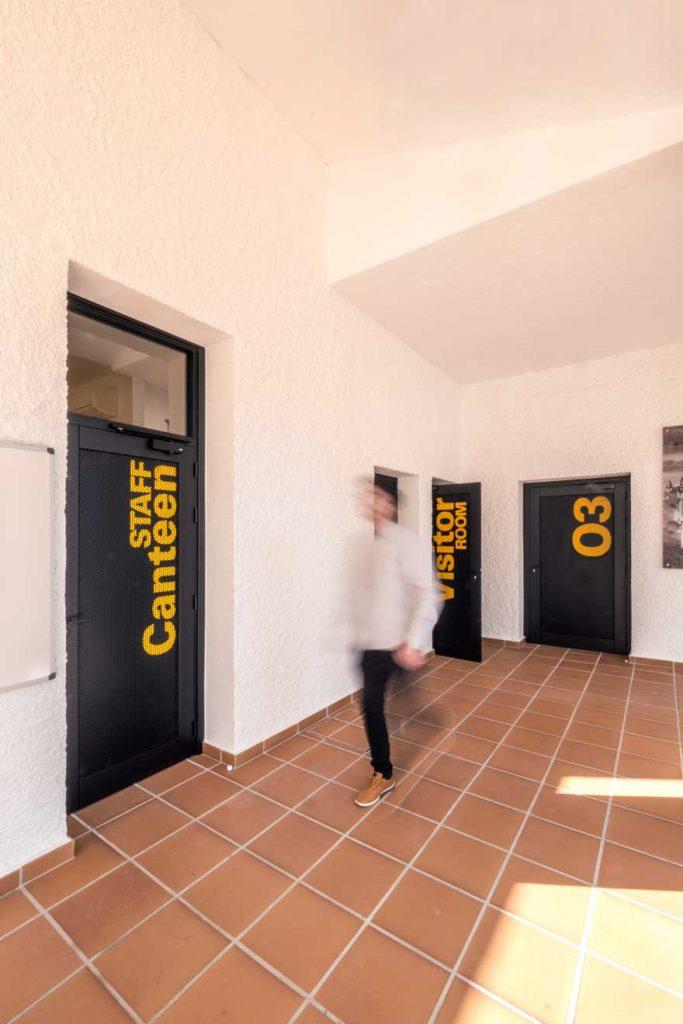 Caterpillar corporate door signage design