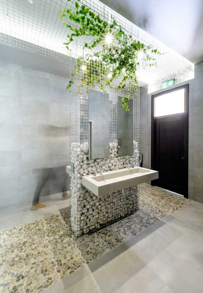 Stone toilet design at Caterpillar Málaga