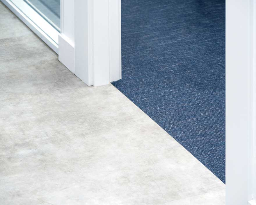Blue and gray floor detail in office design